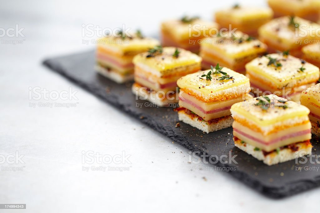 Canepes with cheese and salami royalty-free stock photo