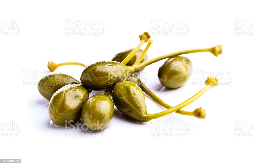canned capers on white reflective background stock photo