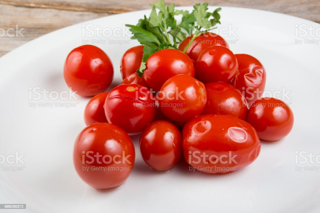 Canned cherry tomatoes stock photo