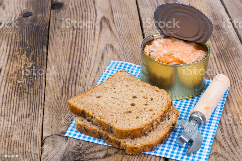 Canned fish salmon or tuna in open metal can stock photo