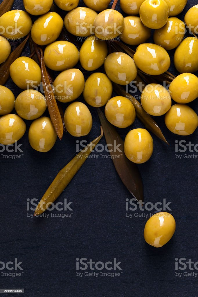 canned green olives stock photo