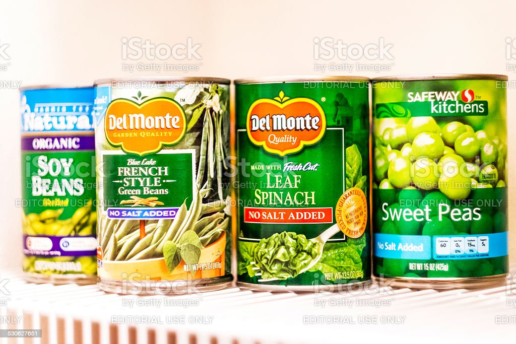 Canned green vegetables in kitchen pantry stock photo