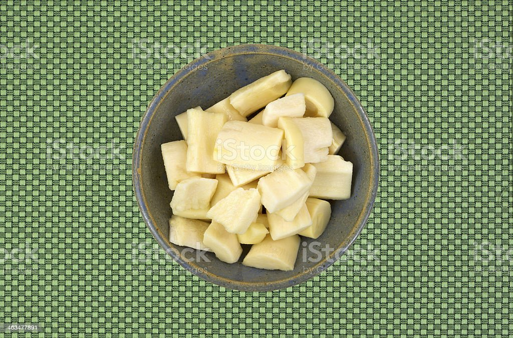 Canned palm hearts in an old bowl stock photo