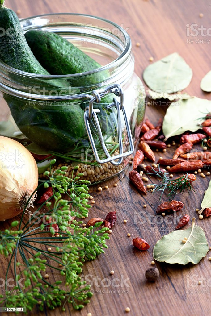 canned pickle in jar with spices stock photo
