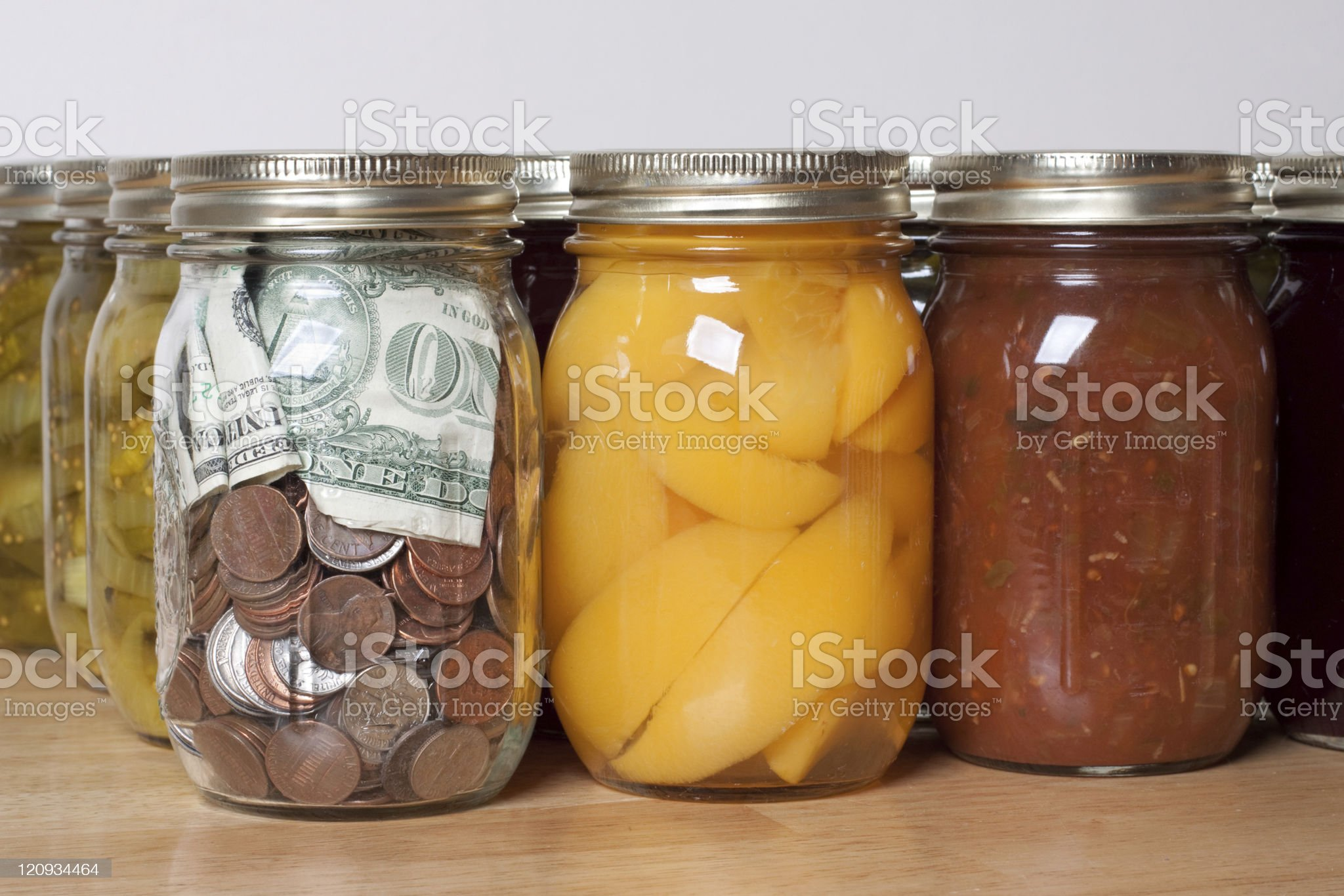 Canned Produce and USD Currency in Home Storage Canning Jars royalty-free stock photo