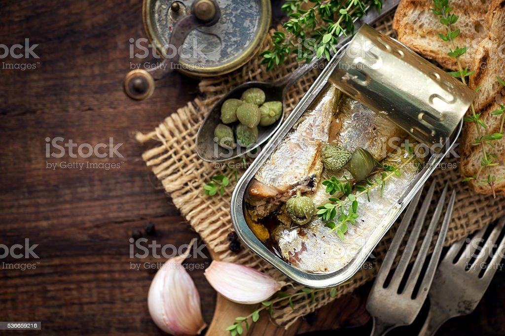 Canned sardines with capers stock photo