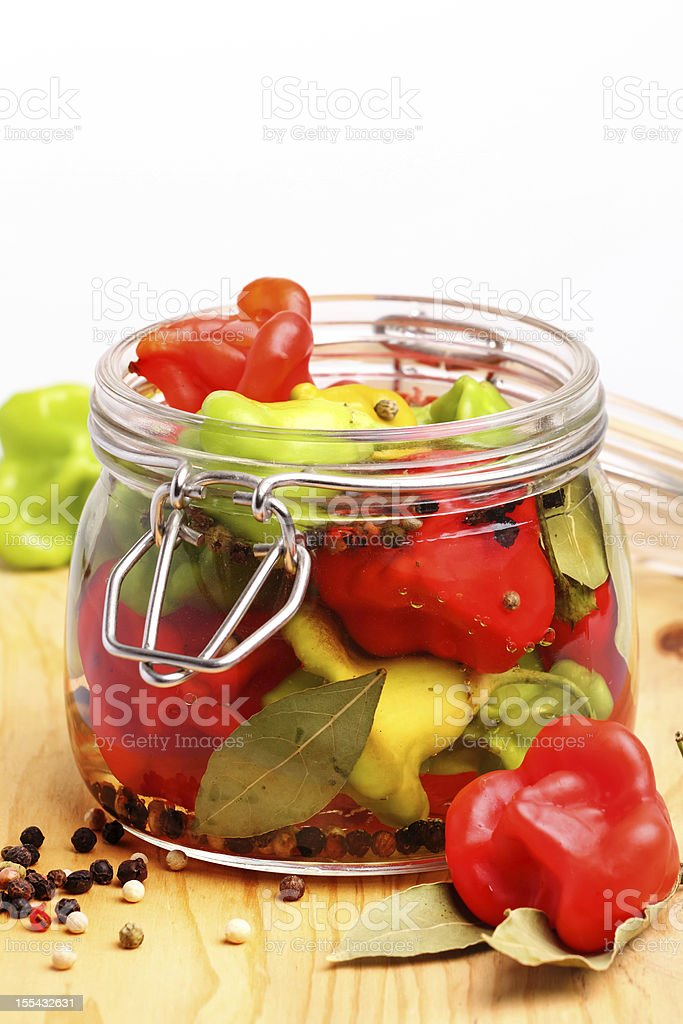 Canned small peppers with ingredients royalty-free stock photo