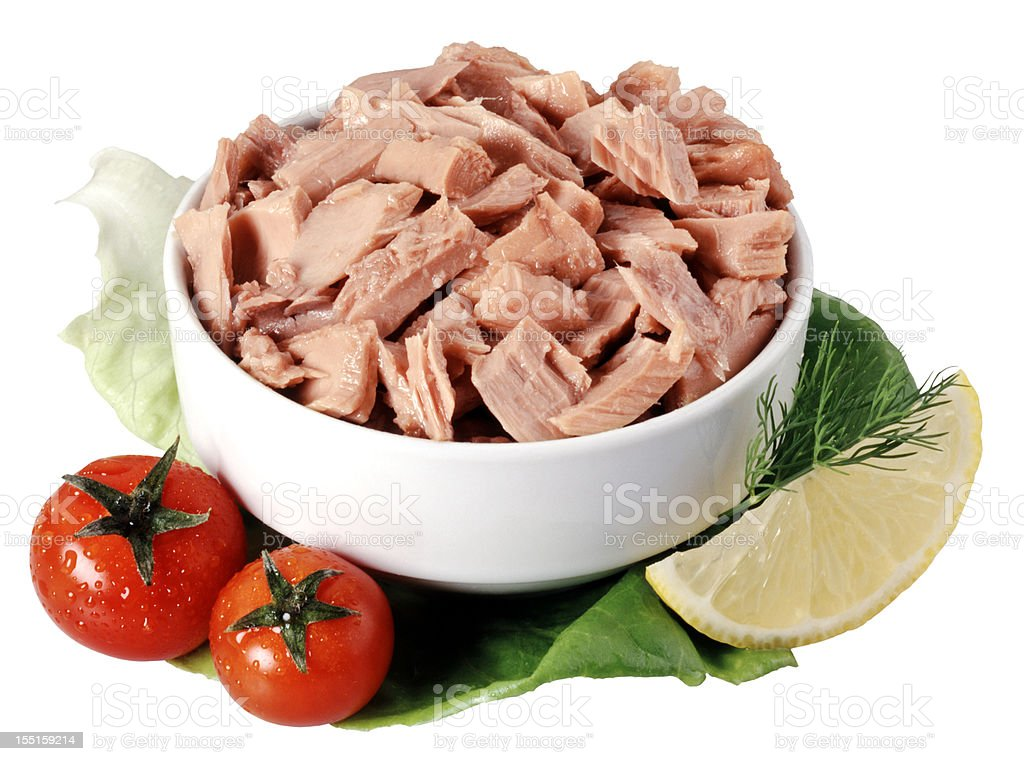 Canned tuna chunks in a bowl garnished with tomatoes stock photo