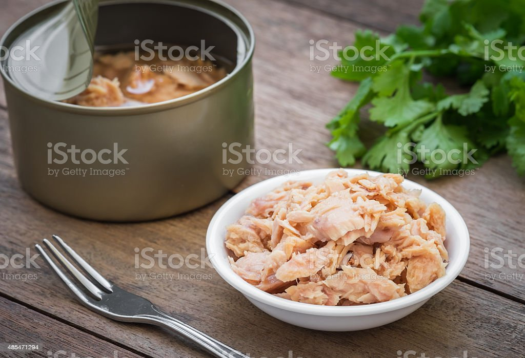 Canned tuna fish in bowl stock photo