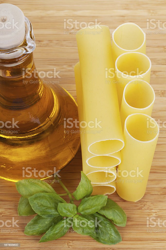 Cannelloni with olive oil in a glass bottle royalty-free stock photo
