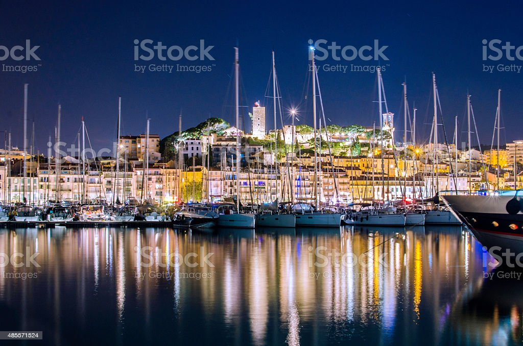 Cannes in France illuminated at night stock photo