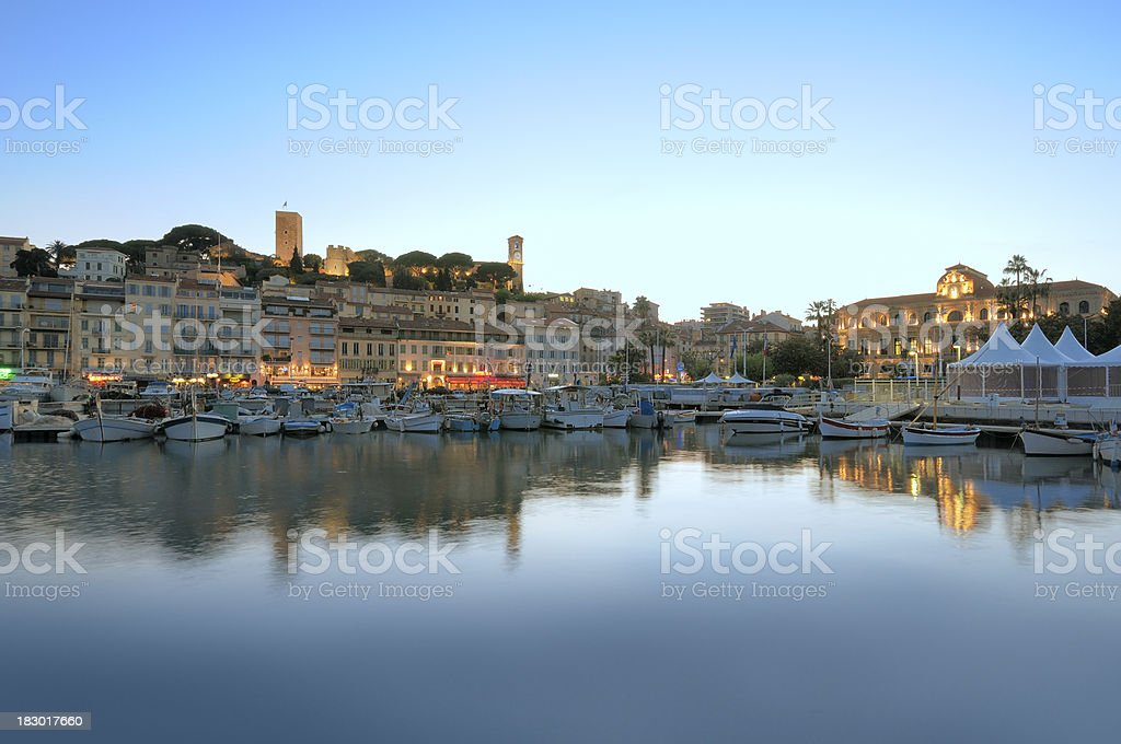 Cannes in the evening viewed from harbor stock photo