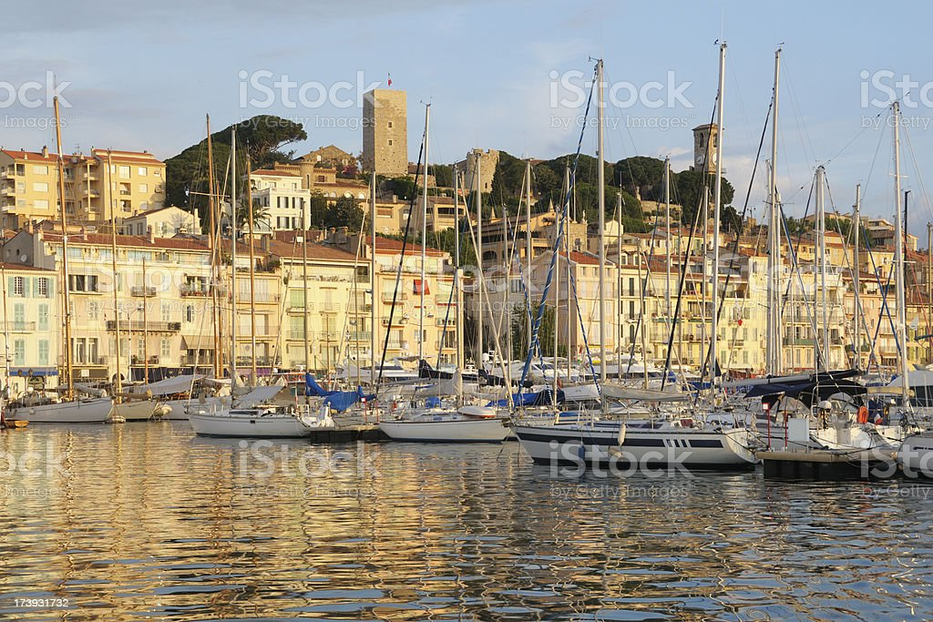 Cannes in the morninig seen through mast of sailing boats royalty-free stock photo