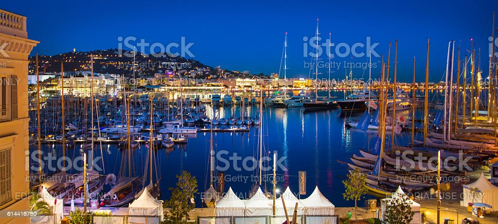 Cannes port with lots of yachts at night.  France stock photo