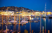 Cannes port with lots of yachts at night.  France