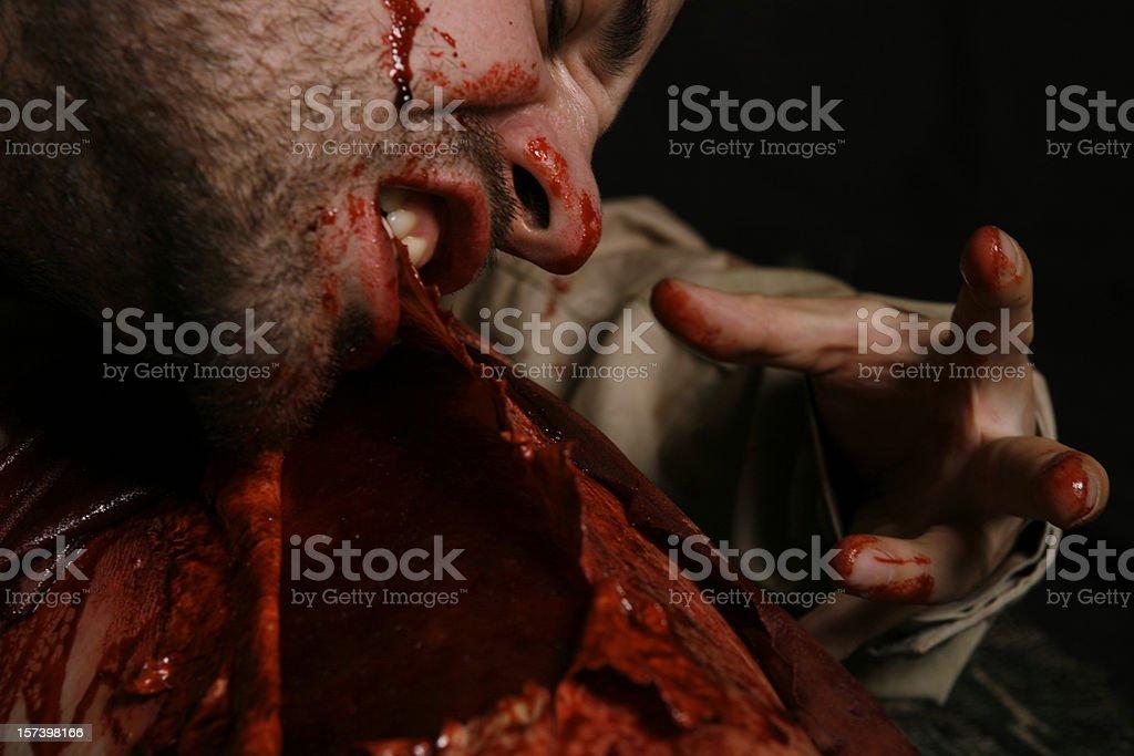 Cannibalism stock photo