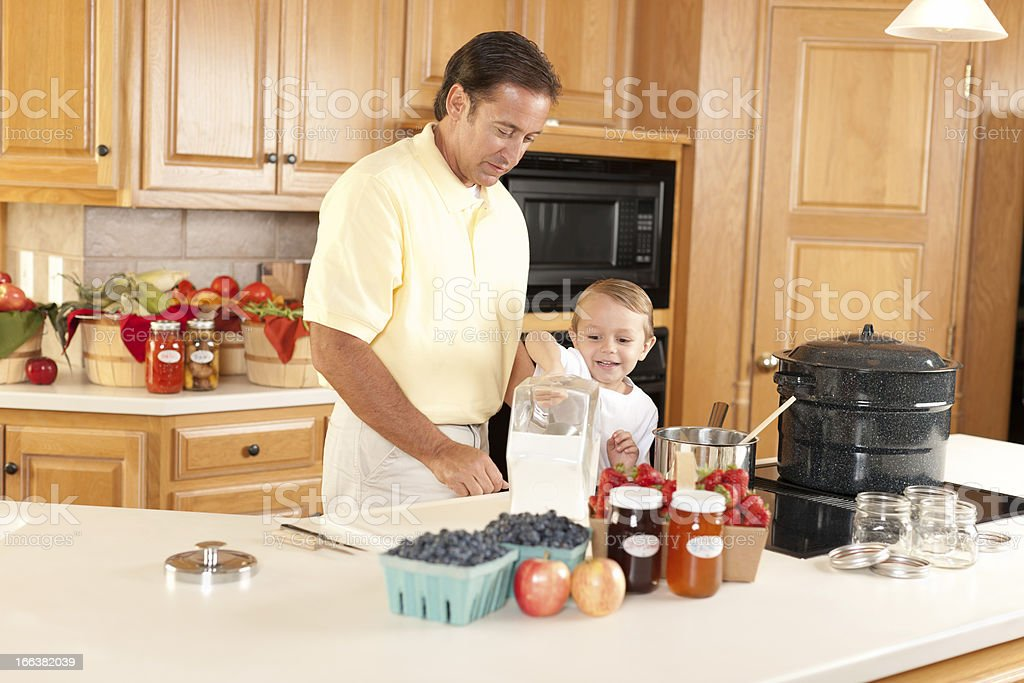 Canning: Father Son Making Homemade Preserves Using Homegrown Fruits Vegetables royalty-free stock photo