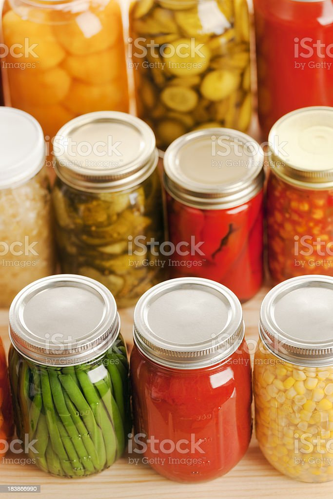 Canning Glass Jars of Vegetables, Fruit and Pickled Preserves Food royalty-free stock photo