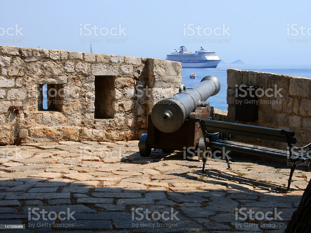 Cannon and cruise ship royalty-free stock photo