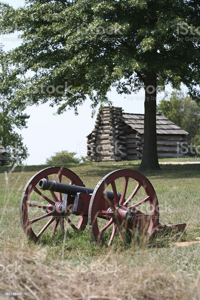 Cannon and Log Cabin stock photo