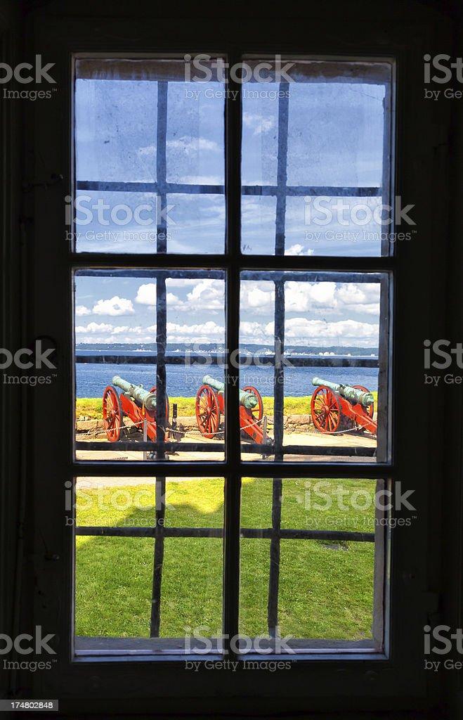 Cannon as seen through the window of Kronborg Castle, Denmark royalty-free stock photo