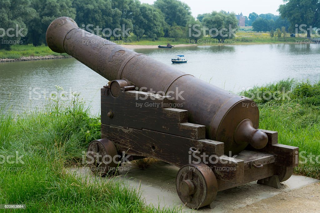 Cannon on fortified city Woudrichem Netherlands  maas and rhine river stock photo