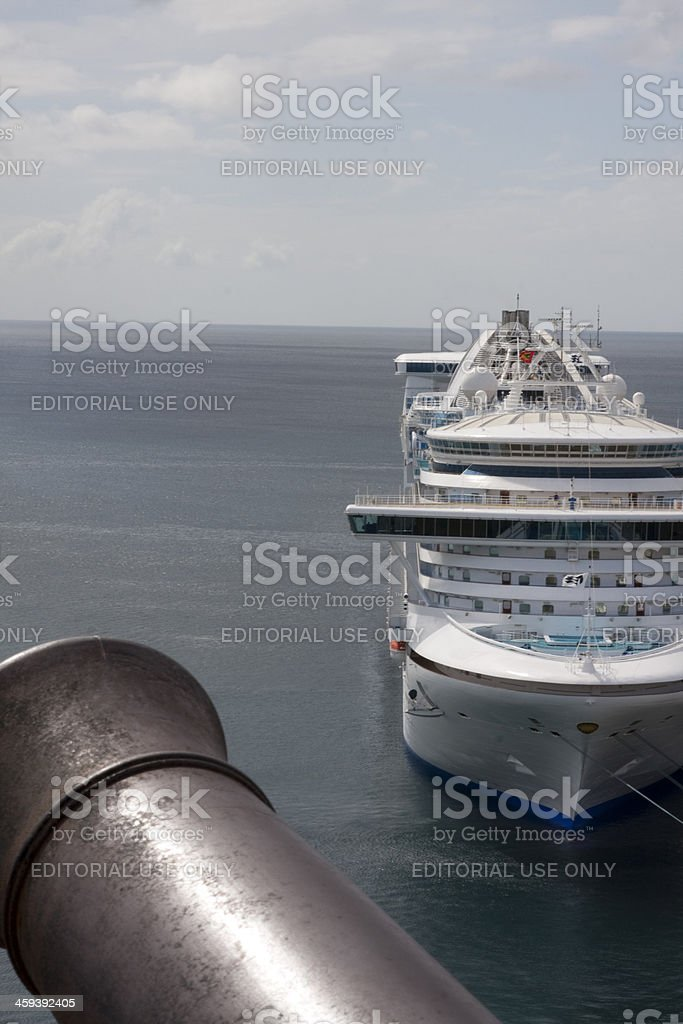 Cannon Watching Over Cruise Ship In Port stock photo