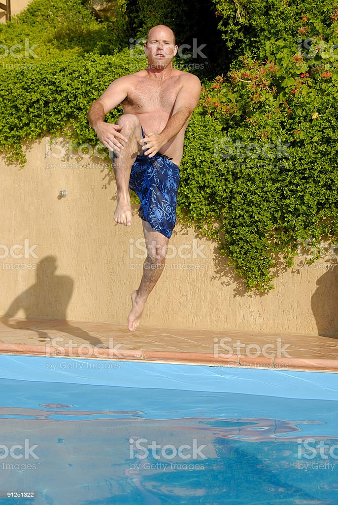 Cannonball into pool stock photo