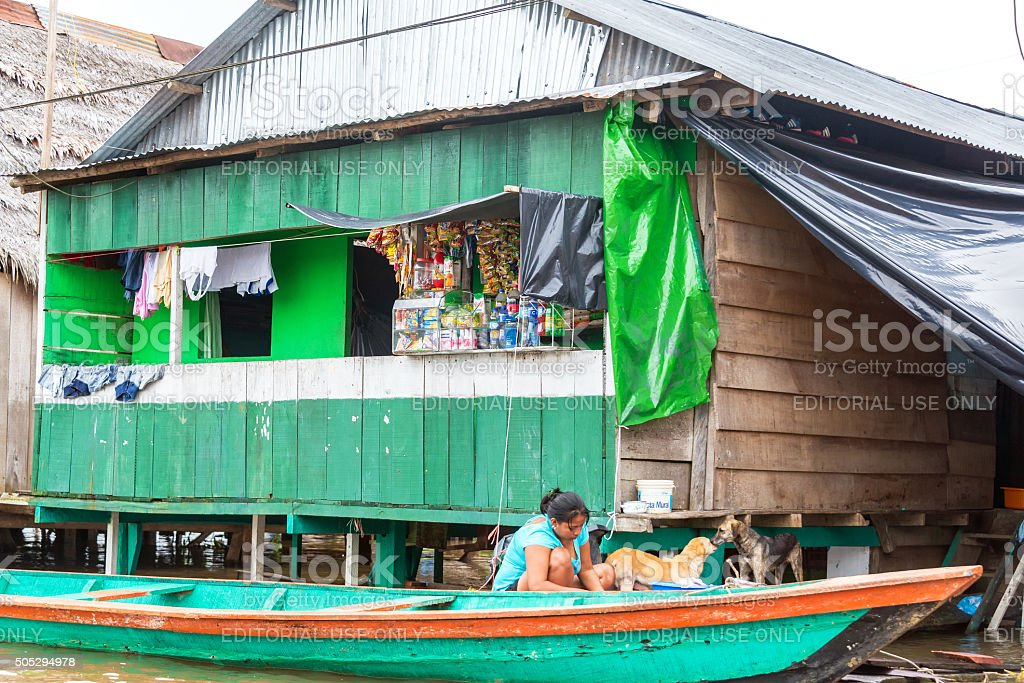 Canoe and Market in Iquitos, Peru stock photo