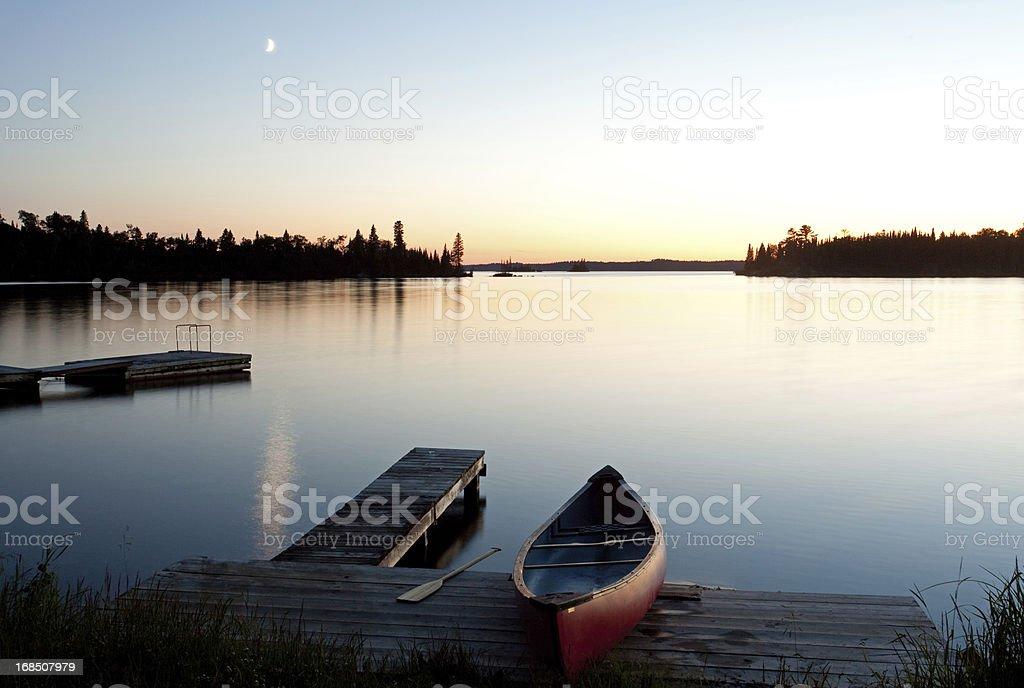 Canoe at the Dock in Muskoka Region of Ontario stock photo