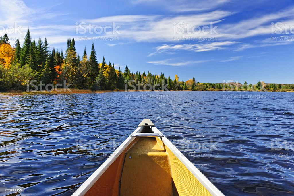 Canoe bow on lake stock photo