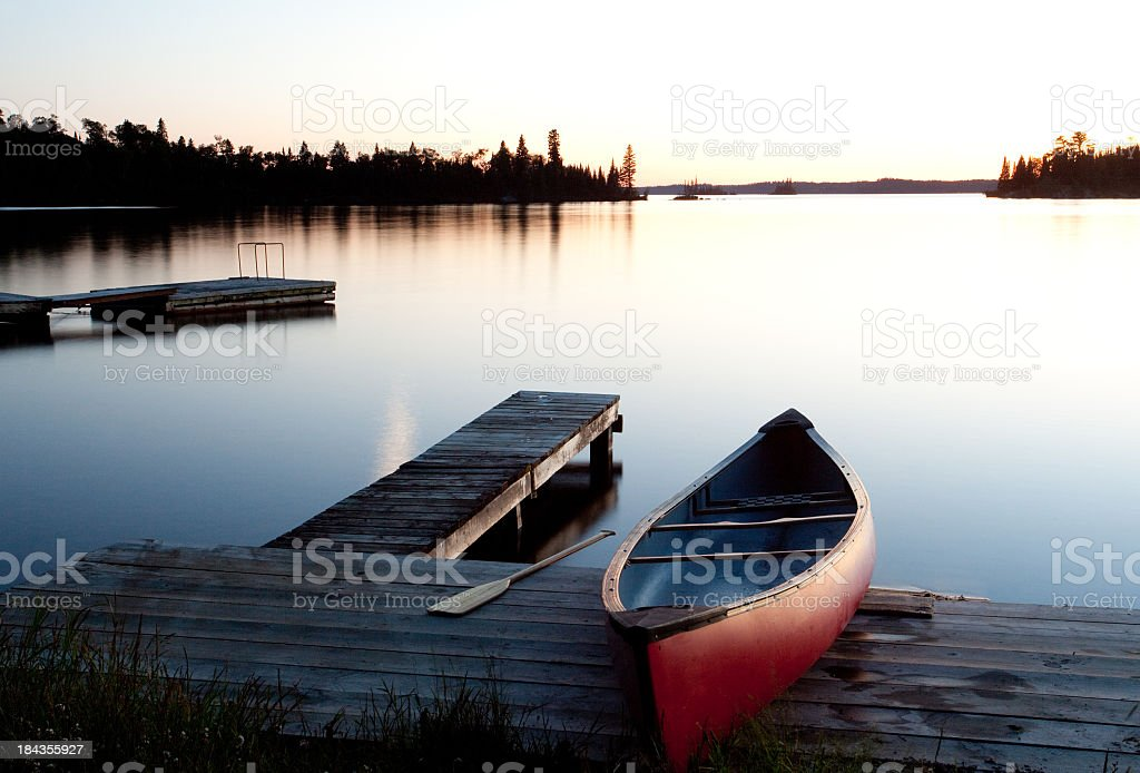 Canoe by the Dock in Muskoka Ontario Canada stock photo