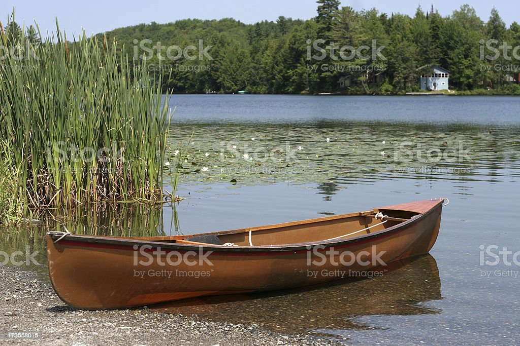 canoe by the lake royalty-free stock photo