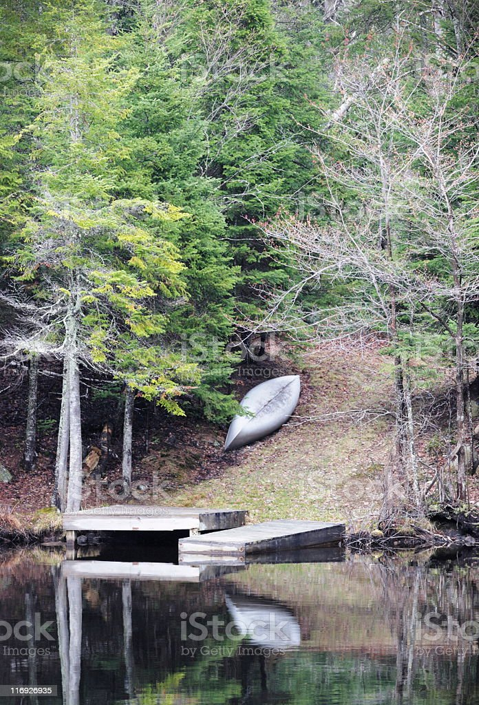 Canoe Dock Lake Reflection Wilderness Vacation royalty-free stock photo