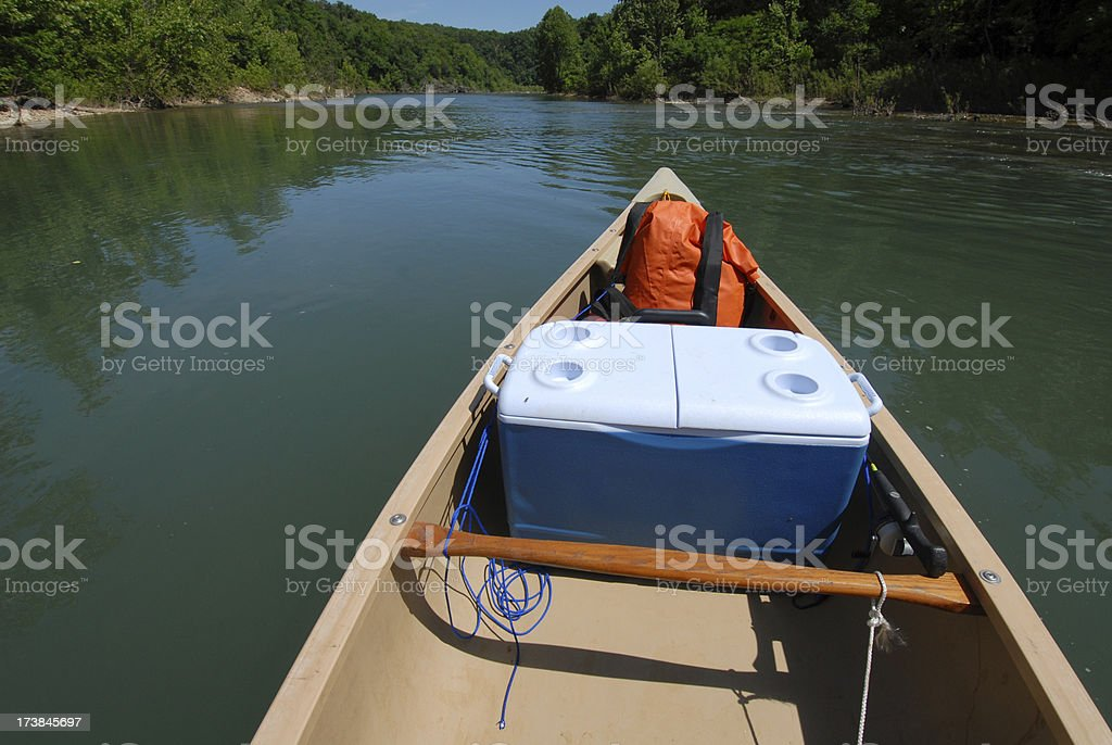 Canoe Floating Down a River stock photo