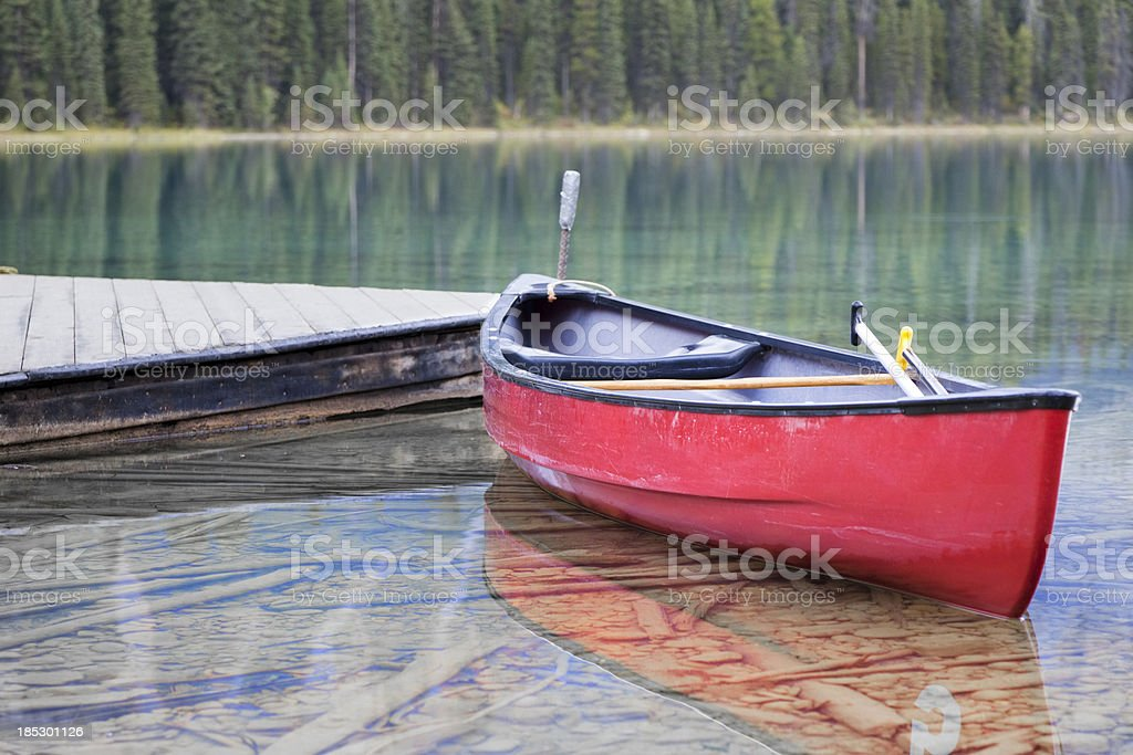 Canoe in crystal-clear Emerald Lake, BC, Canada royalty-free stock photo