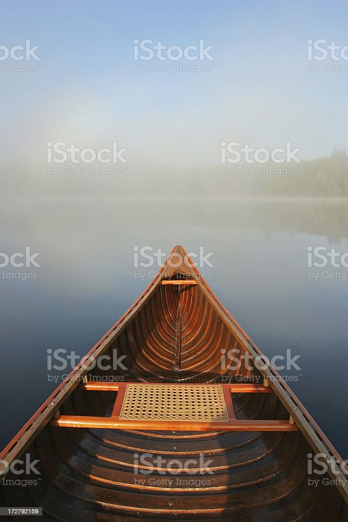 Canoe in the Mist stock photo