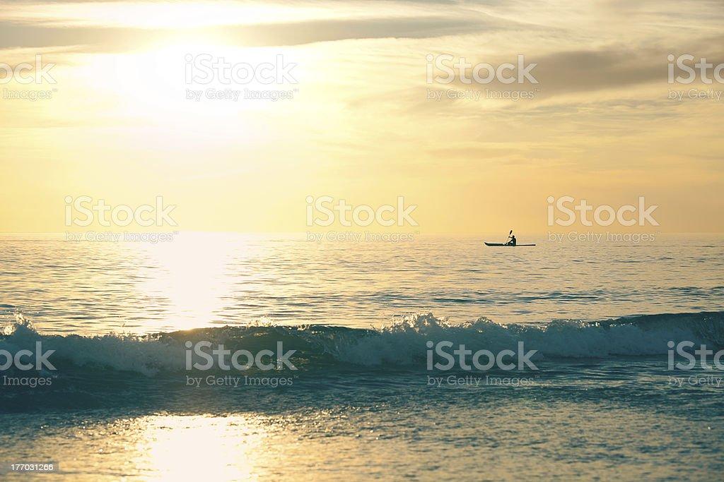 Canoe into the sunset royalty-free stock photo