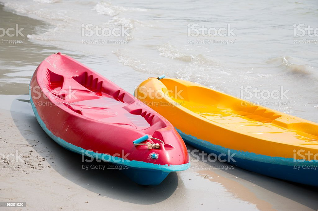 Canoe, kayaks land on the beach at beach. stock photo