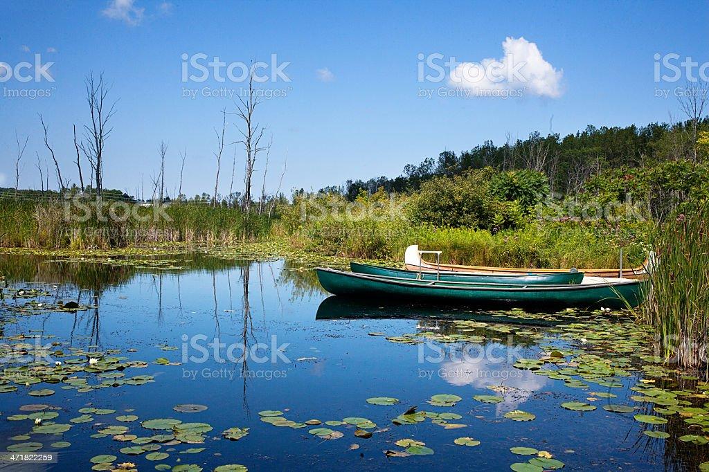 Canoe moored at dock royalty-free stock photo