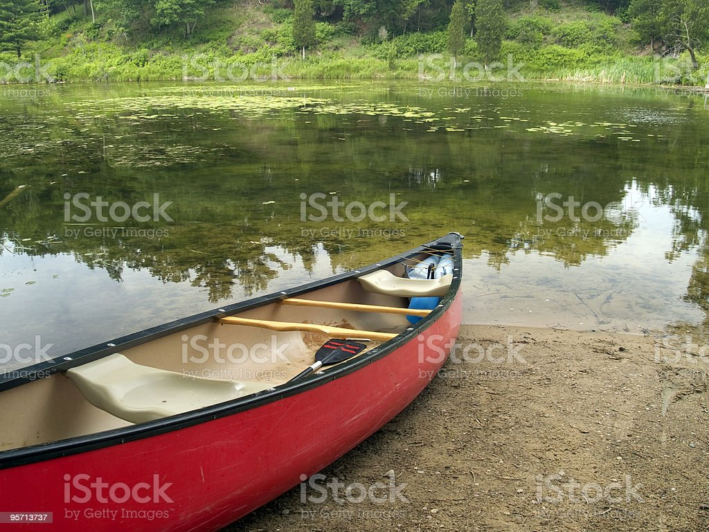 Canoe on a Quiet Shore royalty-free stock photo