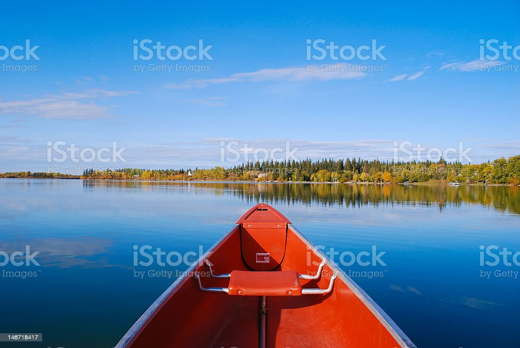 Canoe on calm Lake stock photo