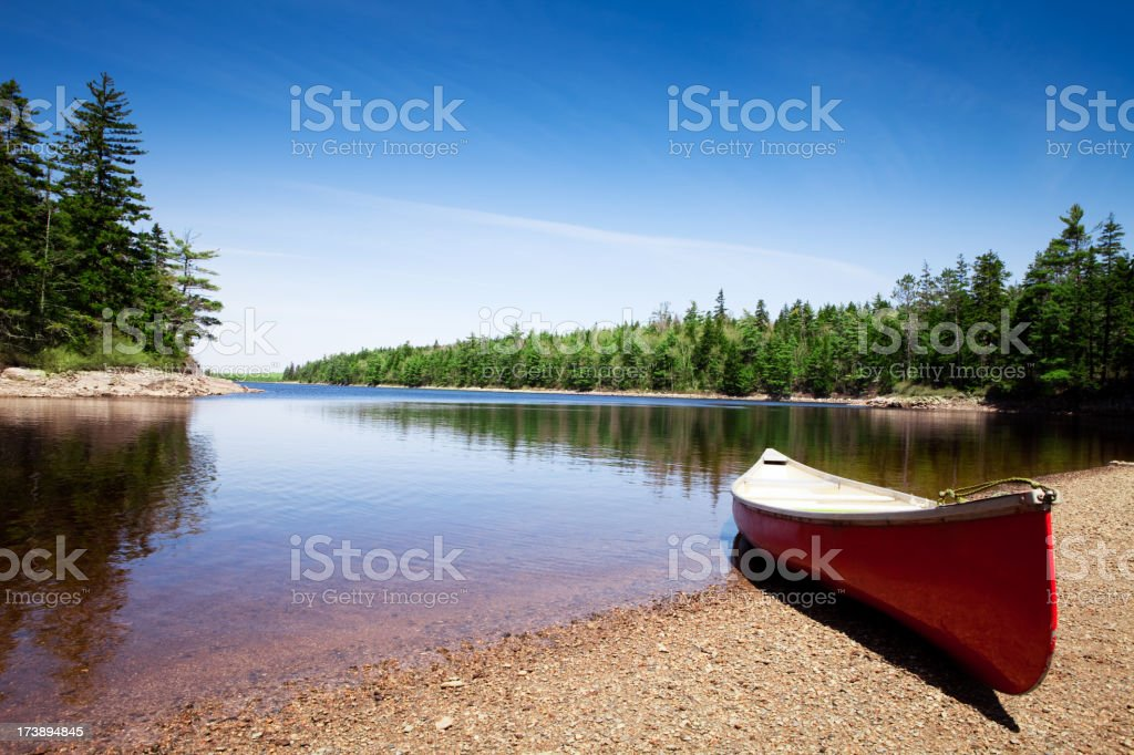 Canoe on lake shore stock photo