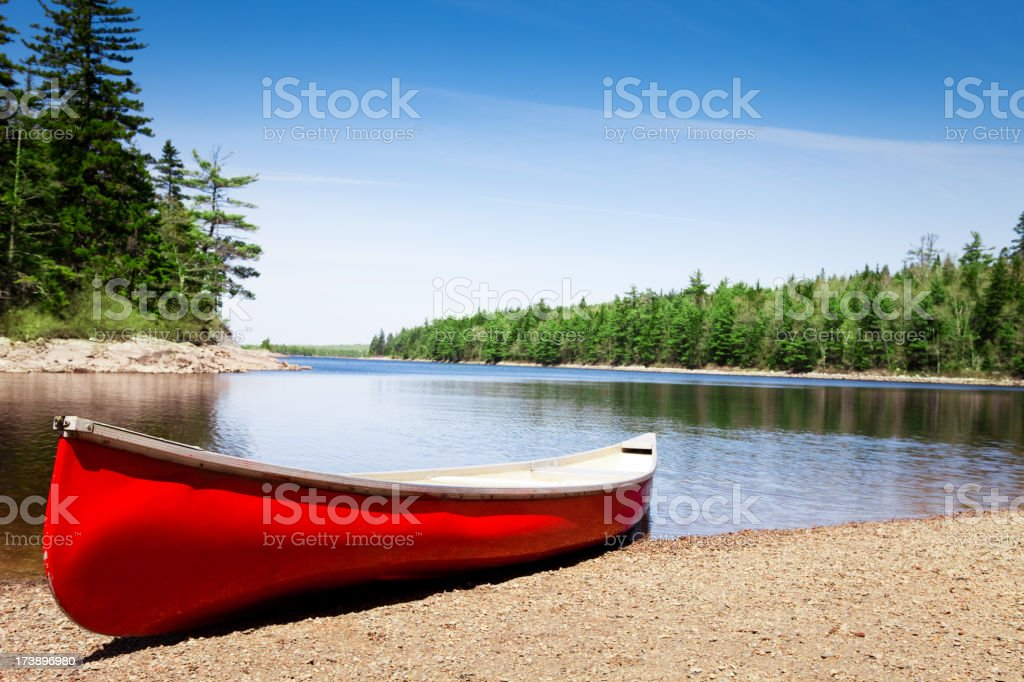 Canoe on lake shore royalty-free stock photo