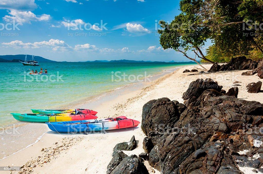 Canoe on the beach in a sunny day in Phuket stock photo