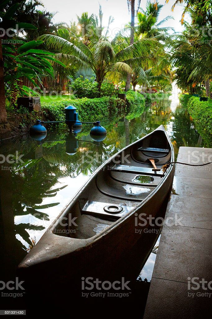 Canoe on the Kerala Backwaters in India stock photo