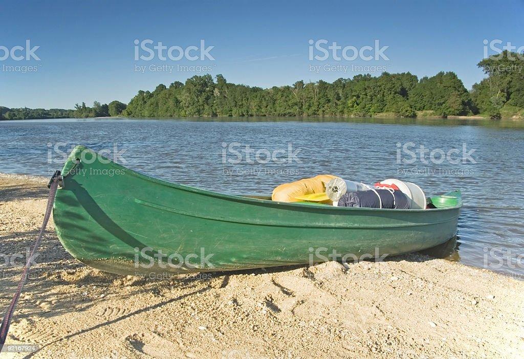 Canoe on the riverbank stock photo