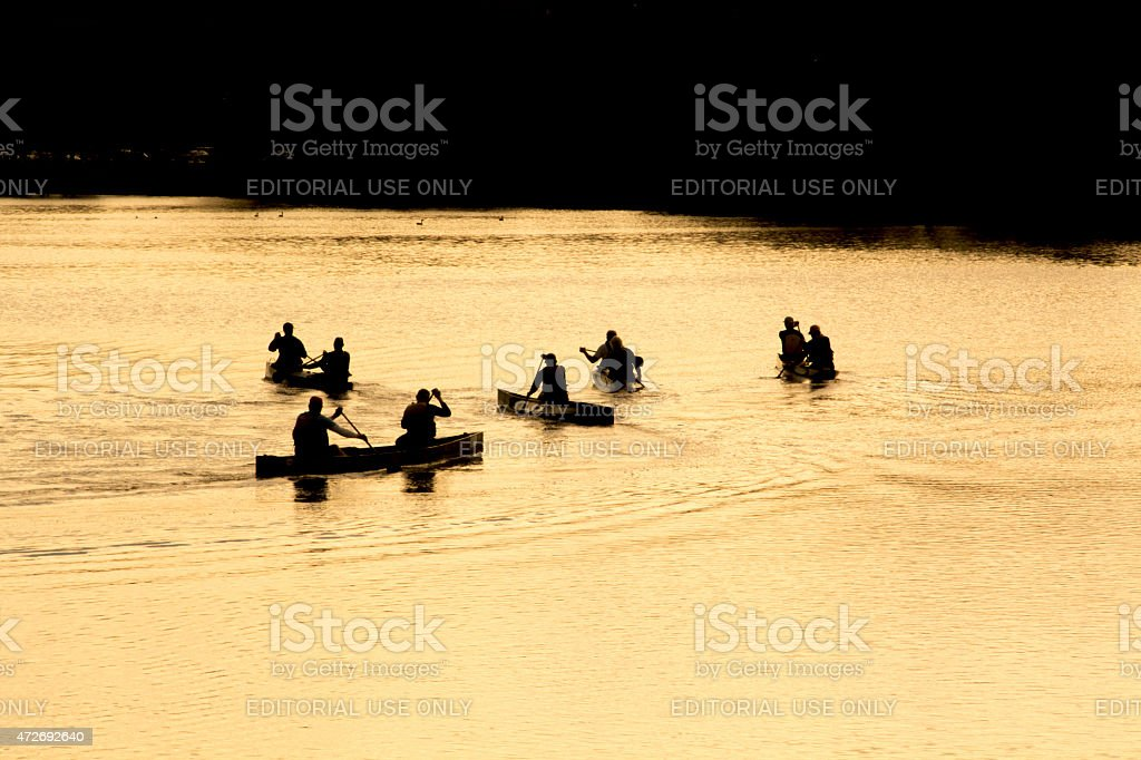 Canoe paddlers in the Charles River, Waltham, MA. stock photo