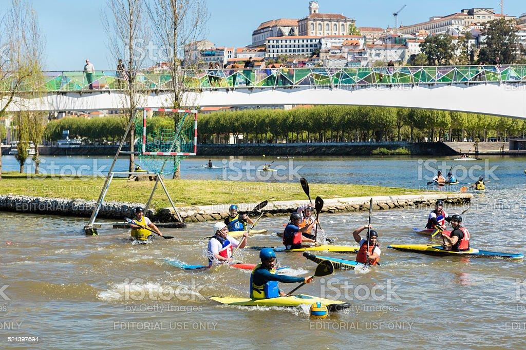 Canoe Polo game in Coimbra Mondego River stock photo