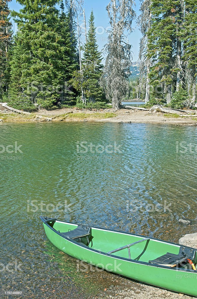 Canoe ready to be launched in volcanic lake royalty-free stock photo